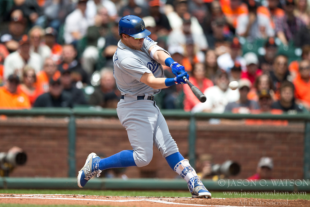 SAN FRANCISCO, CA - MAY 21:  Enrique Hernandez #14 of the Los Angeles Dodgers hits a double against the San Francisco Giants during the first inning at AT&T Park on May 21, 2015 in San Francisco, California.  (Photo by Jason O. Watson/Getty Images) *** Local Caption *** Enrique Hernandez