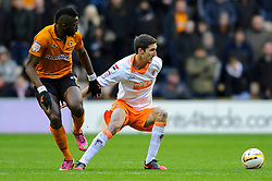 Blackpool Midfielder Chris Basham (ENG) is challenged by Wolves Midfielder Bakary Sako (FRA) during the first half of the match - Photo mandatory by-line: Rogan Thomson/JMP - Tel: Mobile: 07966 386802 26/01/2013 - SPORT - FOOTBALL - Molineux Stadium - Wolverhampton. Wolverhampton Wonderers v Blackpool - npower Championship.