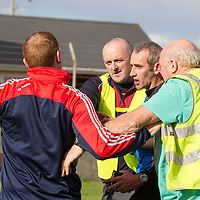 Match Referree being confronted by a member of Corofin's Management Team, Brian Lynch, while being escorted off the pitch by officials at the end of the Intermediate Football Final Replay,between Corofin and Wolfe Tones