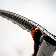 Rain drops collecting on an ice axe.
