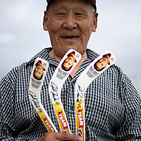Jordin Tootoo grew up in a small village along the Hudson Bay only a hundred miles from the Arctic Circle. The first Inuit to play professionally in the National Hockey League, Tootoo is close to his family and friends to nearly everyone in Rankins Inlet in Northeast Canada. This man walks purchased three souvenir hockey sticks with Jordin's picture on them at a local market.
