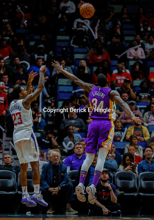 Jan 28, 2018; New Orleans, LA, USA; LA Clippers guard Lou Williams (23) shoots over New Orleans Pelicans guard DeAndre Liggins (34) during the fourth quarter at the Smoothie King Center. The Clippers defeated the Pelicans 112-103. Mandatory Credit: Derick E. Hingle-USA TODAY Sports