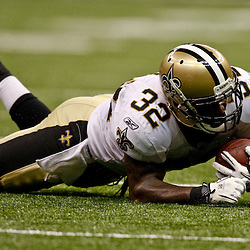 August 21, 2010; New Orleans, LA, USA; New Orleans Saints running back P.J. Hill (32) injures his arm while diving for extra yardage during the second half of a 38-20 win by the New Orleans Saints over the Houston Texans during a preseason game at the Louisiana Superdome. Mandatory Credit: Derick E. Hingle
