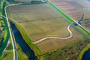 Nederland, Noord-Brabant, Werkendam, 28-10-2014; Ruimte voor de Rivier project Ontpoldering Noordwaard. Grondwerk t.b.v. de aanleg van meanderende kreken.<br /> De Noordwaard wordt ontpolderd door de dijken aan de rivierzijde gedeeltelijk af te graven, hierdoor kan de Nieuwe Merwede bij hoogwater via de Noordwaard sneller naar zee stromen. Gevolg van de ingrepen is ook dat de waterstand verder stroomopwaarts zal dalen.<br /> National Project Ruimte voor de Rivier (Room for the River) By lowering and / or moving the dike of the Noordwaard polder the area will become subject to controlled inundation and function as a dedicated water detention district. Houses and farmhouses will be constructed on new dwelling mounds. <br /> luchtfoto (toeslag op standard tarieven);<br /> aerial photo (additional fee required);<br /> copyright foto/photo Siebe Swart