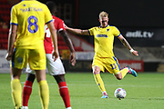 AFC Wimbledon midfielder Mitchell (Mitch) Pinnock (11) with a shot on goal during the EFL Trophy match between Charlton Athletic and AFC Wimbledon at The Valley, London, England on 4 September 2018.