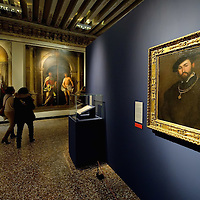 "VENICE, ITALY - NOVEMBER 23:  Two women walk next to two paintings, on the foreground ""Ritratto di Gentiluomo"" by Lorenzo Lotto at the press preview of Tribute to Lorenzo Lotto - The Hermitage Paintings at Accademia Gallery on November 23, 2011 in Venice, Italy. The exhibition which includes two very rare & never seen before paintings opens from the 24th November 2011 to 26th February 2012 in Italy."
