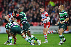 Gloucester Flanker (#6) Tom Savage is tackled by London Irish Winger (#14) Topsy Ojo during the first half of the match - Photo mandatory by-line: Rogan Thomson/JMP - Tel: Mobile: 07966 386802 15/12/2012 - SPORT - RUGBY - Kingsholm Stadium - Gloucester. Gloucester Rugby v London Irish - Amlin Challenge Cup Round 4.
