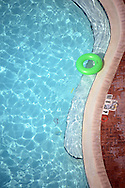 Sarasota, Fl:  Sunday, June 10, 2012-- A lime green life preserver adrift in a pool on Lido Beach,  Florida.  ©Audrey C. Tiernan