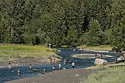 Fishermen catching silver salmon on Bird Creek in Kongiganak, outside Anchorage, Alaska.
