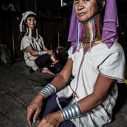 Portrait of Padaung women in their house, Loikaw area, Myanmar, Asia