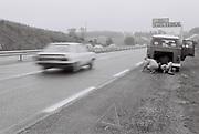 Boys fixing broken down VW Camper van on the motorway, France, 1985