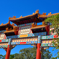 Paifang Gate in China at Epcot in Orlando, Florida<br /> If you have entered a major city's Chinatown, you probably passed under a paifang. These colorful gates evolved in ancient China as entrances to different communities or precincts called fangs. They are also used as a memorial arch over family tombs. Two other common paifangs represent loyalty and chastity. The patterns and characters beneath the tiled rooflines tell the story or significance of each arch. This gate replicates the one at the Temple of Heaven in Beijing.