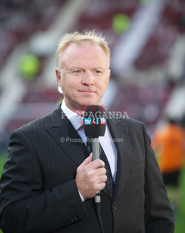EDINBURGH, SCOTLAND - Thursday, August 23, 2012: Alex McLeish working for ITV before the UEFA Europa League Play-Off Round 1st Leg match between Heart of Midlothian and Liverpool at Tynecastle. (Pic by David Rawcliffe/Propaganda)
