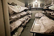One of two over crowded Forensic lockers filled with bodies of shooting victims from the drug war at the Juarez City Forensic Lab in Juarez, Mexico January 16, 2009.  An ongoing drug war has already claimed more than 40 people since the start of the year. More than 1600 people were killed in Juarez in 2008, making Juarez the most violent city in Mexico.    (Photo by Richard Ellis)