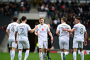 Milton Keynes Dons midfielder (on loan from Leicester City) Harvey Barnes (18) scores a goal and celebrates with The Milton Keynes Dons players during the EFL Sky Bet League 1 match between Milton Keynes Dons and Shrewsbury Town at stadium:mk, Milton Keynes, England on 25 February 2017. Photo by Dennis Goodwin.