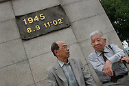 Akira Iwanaga (on left) and Tsutomu Yamaguchi (on right), pay their respects at the memorial stone marking the epicentre of the Nagasaki Atomic bombing blast on 9th August 1945, in Nagasaki, Japan,  Tuesday May 24th 2005. Both men were in Hiroshima on the day of the first atomic bombing, 6th Aug. 1945, and also in Nagasaki three days later on the day of the second atomic bombing of Japan by US Military.