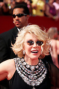 Sept. 4, 2014 - Joan Rivers, the queen of comedy, has died in New York. She was 81. Rivers was undergoing surgery on her vocal cords at a clinic in New York City on Aug. 28 when she stopped breathing and had to be transported to Mount Sinai Hospital. Rivers entered show biz as a stand-up comic. She first gained fame with her appearances on ''The Tonight Show'' with Johnny Carson. Rivers recently transformed herself into a comedian fashion critic of the red carpet with the popular E! Network show, 'Fashion Police.' <br /> <br /> PICTURED: Sept. 18, 2005 - Los Angeles, California, U.S. - JOAN RIVERS arrives to the 57th Annual Primetime Emmy Awards.<br /> ©Exclusivepix