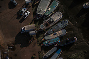 Boats and trucks profit from the low tide to move cargo in Santa Ines port, Amapa, Brazil, Thursday, Oct. 27, 2016.  With a huge estuary to look for the several police forces are called depending on the kind of occurrence but a structured force in the shape of Brazilian road feds is yet to be created.  (Dado Galdieri for The New York Times)