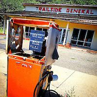 Old retro petrol pump in USA at garage