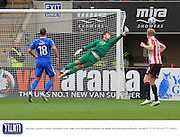 Dillon Phillips makes a save during the Vanarama National League match between Cheltenham Town and Eastleigh at Whaddon Road, Cheltenham, England on 17 October 2015. Photo by Antony Thompson.