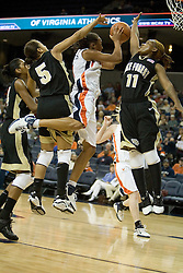 UVA's Lyndra Littles (1) is sandwiched by Wake Forest's Courteney Morris (5) and Yolanda Lavender (11) on her way to the basket.  The Cavaliers defeated the Demon Deacon 77-71 on January 11, 2007 for their first ACC win in the John Paul Jones Arena in Charlottesville, VA.<br />