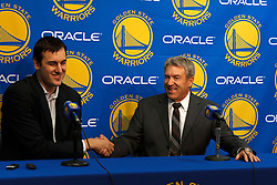 Mar 16, 2012; Oakland, CA, USA; Golden State Warriors general manager Larry Riley (right) introduces center Andrew Bogut (left) before the game against the Milwaukee Bucks at Oracle Arena. Mandatory Credit: Jason O. Watson-US PRESSWIRE