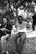 Two men sharing a joke, smoking, and listening to their ghetto blaster, Washington Square Gardens, New York, USA, 1980