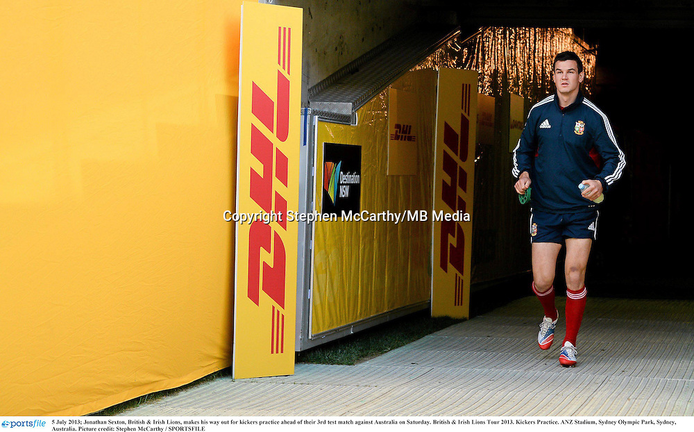5 July 2013; Jonathan Sexton, British & Irish Lions, makes his way out for kickers practice ahead of their 3rd test match against Australia on Saturday. British & Irish Lions Tour 2013, Kickers Practice. ANZ Stadium, Sydney Olympic Park, Sydney, Australia. Picture credit: Stephen McCarthy / SPORTSFILE
