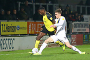Lucas Akins of Burton Albion (10) is tackled by Josh Ruffels of Oxford United  (3) during the EFL Sky Bet League 1 match between Burton Albion and Oxford United at the Pirelli Stadium, Burton upon Trent, England on 11 February 2020.
