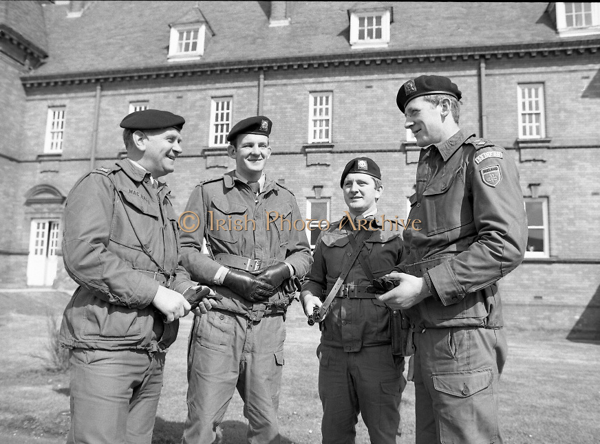 1983-04-12.12th April 1983..Photographed at McKee Barracks, Cork..At Ease..From left to right:..Lieutenant Commandant Patsy McHale..Lieutenant Eugene Doyle of Cork..Sergeant Kevin O'Donovan, Riverstick, Cork..Lieutenant Martin Murphy of Cork