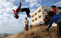 January 2, 2018 - Gaza, Palestinian Territories, Palestine - A Palestinian boy jumps over sand on the beach front of Shatie refugee camp, in Gaza City, on January 2, 2018. (Credit Image: © Majdi Fathi/NurPhoto via ZUMA Press)