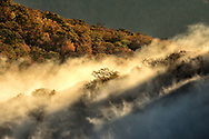 Autumn Colors and mist at sunrise, Blue Ridge Mountains from Blue Ridge Parkway at sunrise, North Carolina