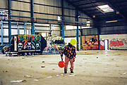 Person with balloons inside a warehouse at Trumpkin Tek, Wales, 29 October 2016