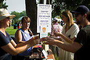 Festival attendees line up for craft cocktails during the Makeshift Festival at Tenney Park in Madison, Wisconsin, Sunday, Aug. 12, 2018.