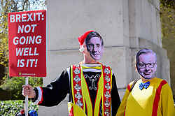© Licensed to London News Pictures. 01/04/2019. LONDON, UK. Pro-Remain supporters wear Jacob Rees-Mogg and Michael Gove face-masks during a protest outside the Houses of Parliament. MPs are debating eight motions related to Brexit with voting to begin later this evening.  Photo credit: Stephen Chung/LNP