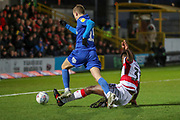 AFC Wimbledon attacker Marcus Forss (15) getting fouled by Doncaster Rovers defender Donervon Daniels (33) for a penalty during the EFL Sky Bet League 1 match between AFC Wimbledon and Doncaster Rovers at the Cherry Red Records Stadium, Kingston, England on 14 December 2019.