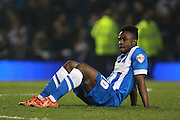 Brighton midfielder winger Kazenga LuaLua is distraught at the final whistle during the Sky Bet Championship play-off second leg match between Brighton and Hove Albion and Sheffield Wednesday at the American Express Community Stadium, Brighton and Hove, England on 16 May 2016. Photo by Bennett Dean.