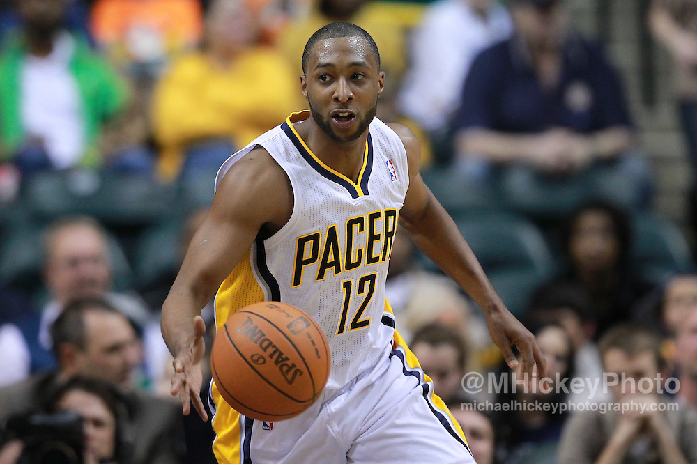 Feb. 28, 2012; Indianapolis, IN, USA; Indiana Pacers guard A.J. Price (12) brings the ball up the court against the Golden State Warriors at Bankers Life Fieldhouse. Indiana defeated Golden State 102-78. Mandatory credit: Michael Hickey-US PRESSWIRE