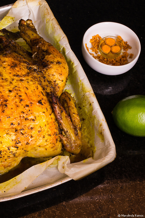 This roast chicken gets its deep mellow color and flavor from turmeric.  Lime and thyme add sparkle and aroma.