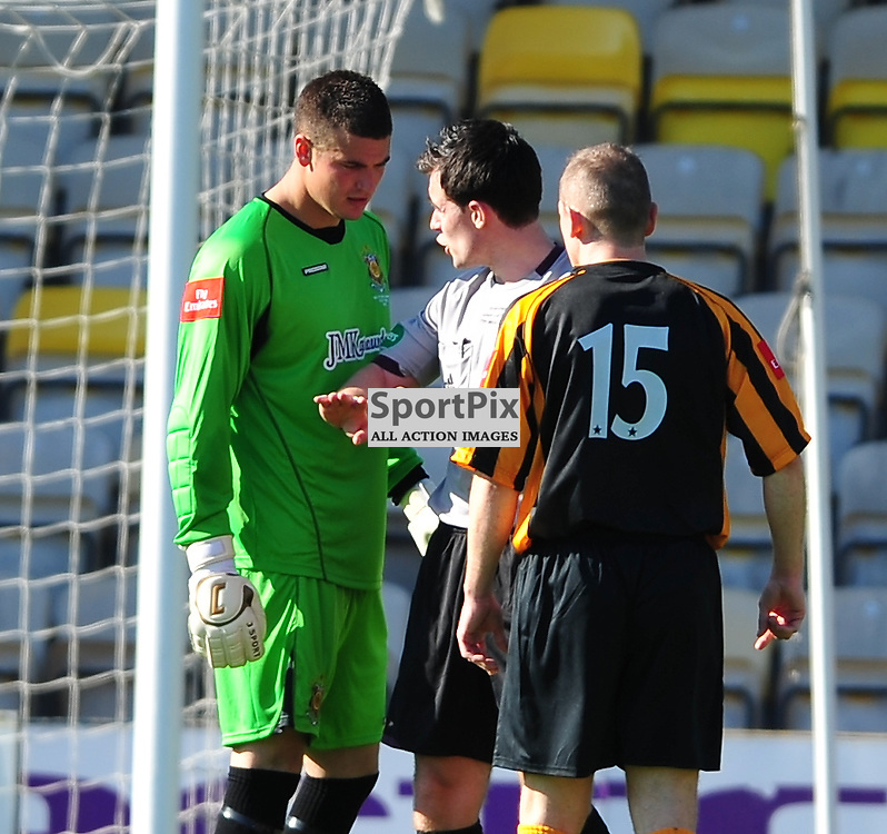 Bryan Slavin (Auchinleck, stripes, 15) and his team-mate Andy Leishman argue and are spoken to by Referee Don Robertson ..Auchinleck Talbot v Shotts Bon Accord, Emirates Junior Cup Final, Sunday 27th May 2012..ALEX TODD | STOCKPIX.EU