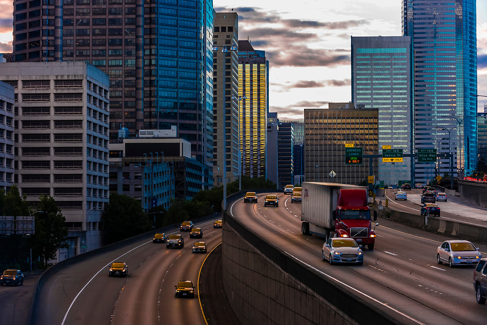 Interstate 5 in foreground with Downtown Seattle behind, Seattle, Washington USA.