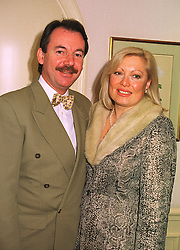 MR & MRS ERIC KNOWLES he is the TV antique expert, at a lunch in london on 10th December 1998.MMW 28