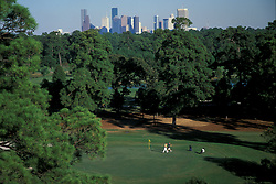 Stock photo of a pair of men playing a round of golf at the Hermann Park golf course