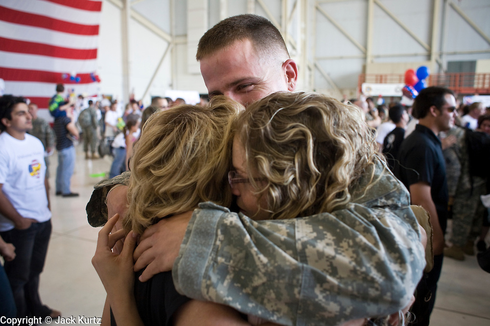 """30 MARCH 2008 -- PHOENIX, AZ: Arizona National Guard soldiers greet their loved ones after they returned to Phoenix, AZ, Sunday from a year long deployment to Afghanistan. About 250 members of the Arizona Army National Guard's 158th Infantry Battalion returned to Phoenix, AZ, from a year long deployment in Afghanistan Sunday. The unit, also known as the """"Bushmasters"""" from their service in World War II, was part of the largest single-unit deployment of the Arizona National Guard since the second World War. Two members of the battalion were killed in action during their deployment. The battalion, a combat unit, engaged in counter insurgency operations through out their deployment. Photo by Jack Kurtz / ZUMA Press"""