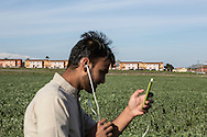 Mineo, Sicily, Italy, April 2015<br /> In the region of Catania, Sicily, lies the biggest center for asylum seekers in Europe, &quot;CARA&quot; (Centro di Accoglienza per Richiedenti Asilo), near the village of Mineo. Over four thousand migrants live in this ancient village built initially to host families of US army soldiers, from a military base nearby. The center is built like a real village with its health center, nursery, administrative buildings, dining hall, stadium ... After what is often a dreadful crossing of the Mediterranean Sea, the survivors have to wait up to fifteen months to obtain a possible residence permit. Migrants spend time walking around the largest center of an asylum seeker, pending a possible a residence permit &copy; Jean-Patrick Di Silvestro