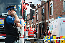 © Licensed to London News Pictures . 08/07/2017 . Bolton , UK . Scene on Rosamond Street in Daubhill , where a fatal house fire burned through a mid-terrace house this morning (Saturday 8th July 2017) . Firefighters responded at 9am this morning (Saturday 8th July 2017) . A family of five are reported to have been inside at the time and there are understand to me multiple fatalities . Photo credit : Joel Goodman/LNP