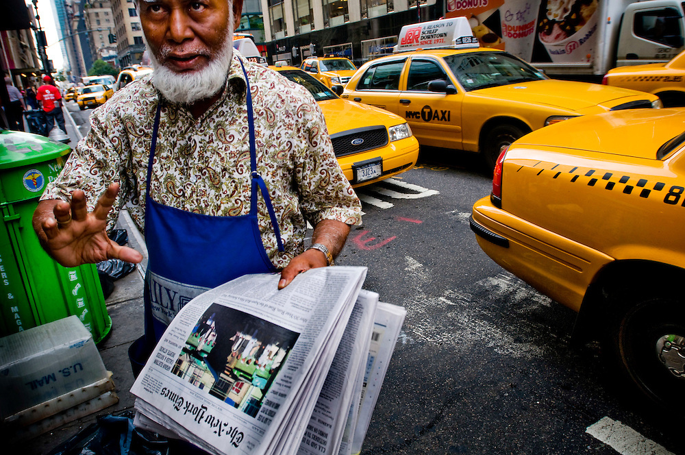 Crisis in the newspaper industry.  New Yorkers and their news reading habits...Arman, the bangladeshi newspaper salesman outiside Grand Central Station gets 20 copies of New York Times each morning. Today he sold two....Photographer Chris Maluszynski /MOMENT