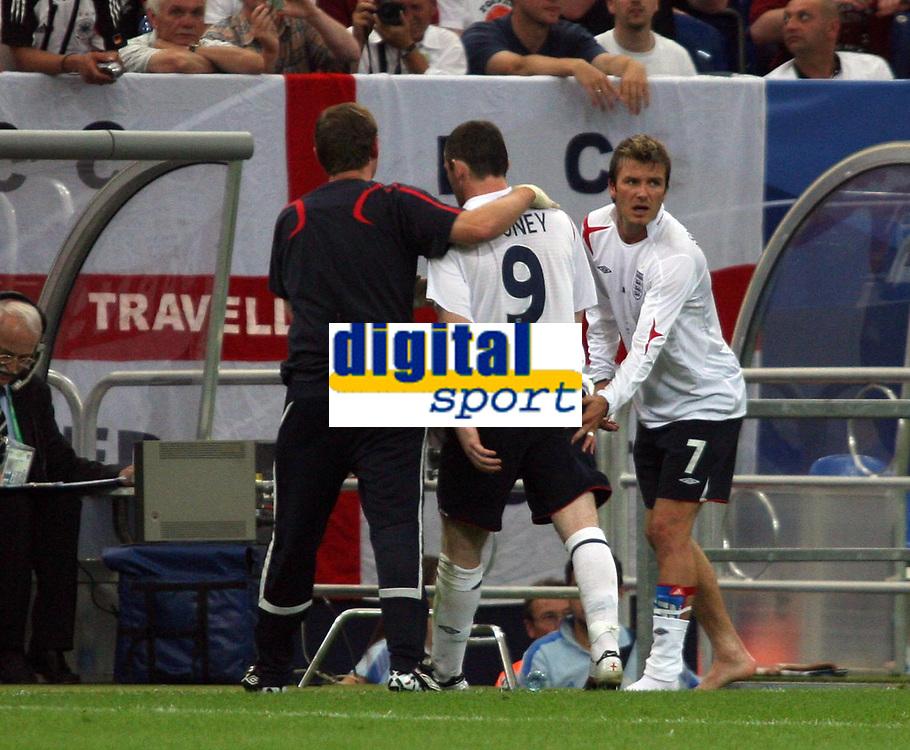 Photo: Chris Ratcliffe.<br /> England v Portugal. Quarter Finals, FIFA World Cup 2006. 01/07/2006.<br /> Wayne Rooney of England leaves the field as David Beckham escorts him off.