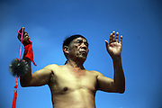 PUTIAN, CHINA - FEBRUARY 20: <br /> <br /> Mans back Beaten With Thorny Iron Ball during Ceremony <br /> <br /> Villagers in Putian hold the \&quot;Da Tie Qiu\&quot; event on Feb 24 in lunar calendar to commemorate Qi Jiguang, a national hero in Ming dynasty. During the event, selected unmarried men baring their upper bodies and feet sit on the knife-made palanquins and beat their backs with thorny iron balls. Beating back with an iron ball stuck with 360 steel nails is said to encourage men to guard the safety of their home and country.<br /> &copy;Exclusivepix Media