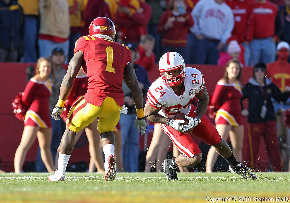 November 06 2010: Nebraska Cornhuskers wide receiver Niles Paul (24) tries to avoid Iowa State Cyclones cornerback David Sims (1) during the first half of the NCAA football game between the Nebraska Cornhuskers and the Iowa State Cyclones at Jack Trice Stadium in Ames, Iowa on Saturday November 6, 2010. Nebraska defeated Iowa State 31-30.